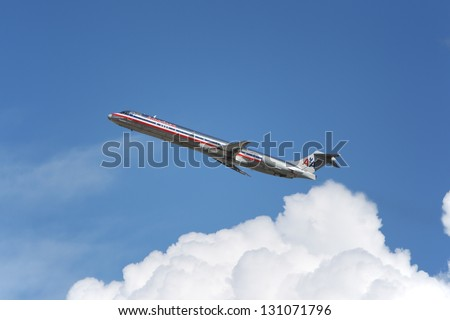 LOS ANGELES, CALIFORNIA, USA - MARCH 8, 2013. American Airlines McDonnell Douglas MD-83 takes off from Los Angeles Airport on March 8, 2013. It seats 155 passengers with a range of 4,600 km. - stock photo