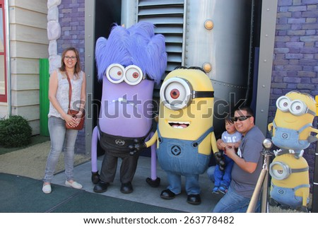Los Angeles, California, USA - March 12, 2015: The character Minions is greeting tourists at Universal Studios Hollywood, which is the first film studio and theme park of Universal Studios. - stock photo