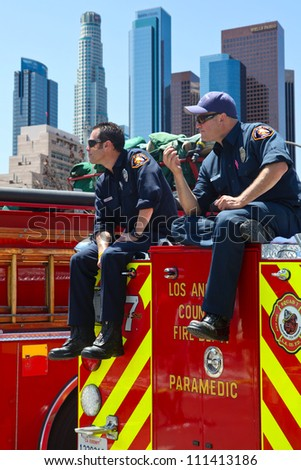 LOS ANGELES, CALIFORNIA, USA - MARCH 3, 2012: Unidentified firefighters watch the people at the Art Festival as a part of security in Los Angeles downtown on March 3, 2012 in Los Angeles, California - stock photo