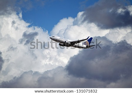 LOS ANGELES, CALIFORNIA, USA - MARCH 8, 2013 - United Airlines Boeing 737 takes off from Los Angeles Airport on March 8, 2013. The plane has a range of 6,340 miles with 177 seats. - stock photo