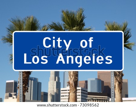 Los Angeles city limit sign with towers and Palm Trees.