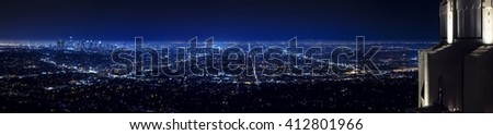 Los Angeles city skyline panorama at night with Griffith observatory on the right - stock photo