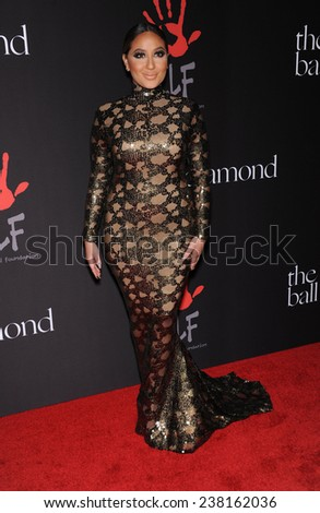LOS ANGELES - DEC 11:  Adrienne Bailon arrives to the The First Annual Diamond Ball on December 11, 2014 in Beverly Hills, CA                 - stock photo
