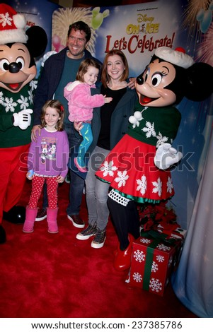 "LOS ANGELES - DEC 11:  Alyson Hannigan, Alexis Denisof, Satyana Denisof, Keeva Denisof at the ""Disney on Ice"" Red Carpet Reception at the Staples Center on December 11, 2014 in Los Angeles, CA"