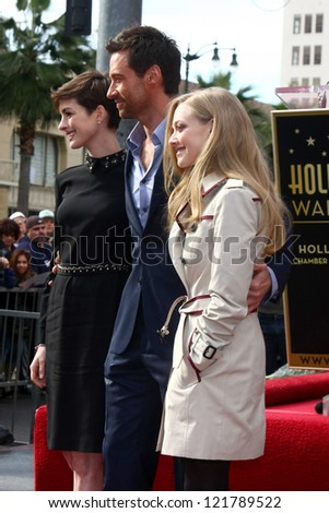 LOS ANGELES - DEC 13:  Anne Hathaway, Hugh Jackman, Amanda Seyfried at the Hollywood Walk of Fame ceremony for Hugh Jackman at Hollywood Boulevard on December 13, 2012 in Los Angeles, CA - stock photo