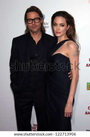 """LOS ANGELES - DEC 8:  Brad Pitt & Angelina Jolie """"In The Land of Blood and Honey"""" Los Angeles Premiere  on December 08, 2011 in Hollywood, CA - stock photo"""