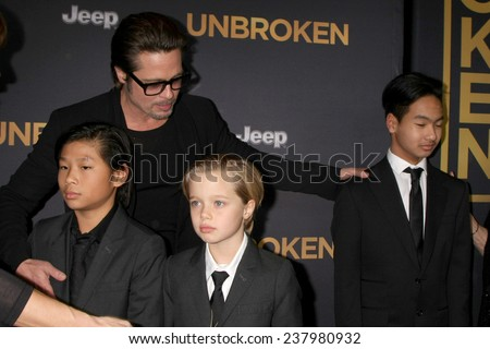 "LOS ANGELES - DEC 15: Brad Pitt, Pax Thien Jolie-Pitt, Shiloh Nouvel Jolie-Pitt, Maddox Jolie-Pitt at the ""Unbroken"" - Los Angeles Premiere at the Dolby Theater on December 15, 2014 in Los Angeles, CA - stock photo"