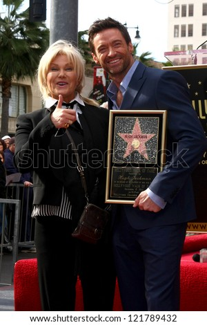 LOS ANGELES - DEC 13:  Deborra-Lee Furness, Hugh Jackman at the Hollywood Walk of Fame ceremony for Hugh Jackman at Hollywood Boulevard on December 13, 2012 in Los Angeles, CA - stock photo
