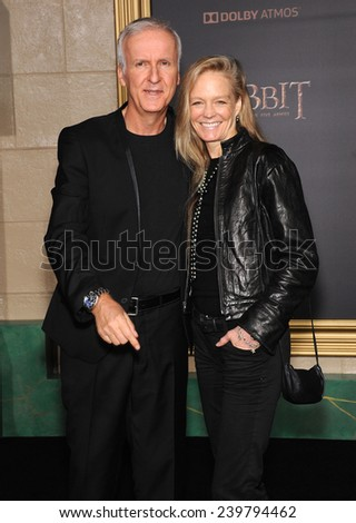 """LOS ANGELES - DEC 09:  James Cameron & Suzy Amis arrives to the """"The Hobbit: The Battle Of The Five Armies"""" Los Angeles Premiere  on December 9, 2014 in Hollywood, CA                 - stock photo"""