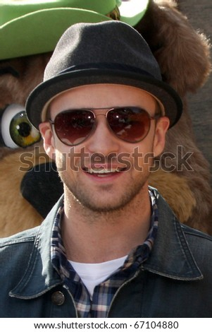 """LOS ANGELES - DEC 11:  Justin Timberlake arrives at the """"Yogi Bear 3-D"""" Premiere at The Village Theater on December 11, 2010 in Westwood, CA. - stock photo"""