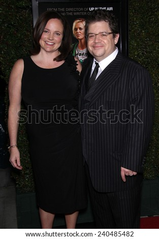 "LOS ANGELES - DEC 15:  PATTON OSWALT & WIFE arrives to the ""Young Adult"" Los Angeles Premiere  on December 15, 2011 in Beverly Hills, CA                 - stock photo"