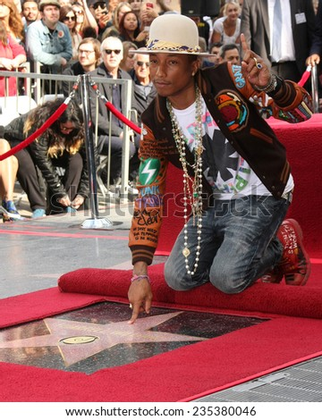 LOS ANGELES - DEC 4:  Pharrell Williams at the Pharrell Williams Hollywood Walk of Fame Star Ceremony at the W Hotel Hollywood on December 4, 2014 in Los Angeles, CA - stock photo