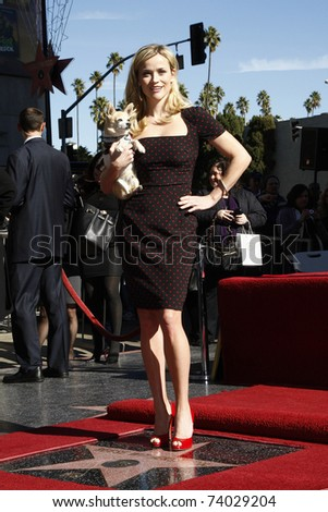 LOS ANGELES - DEC 1: Reese Witherspoon receives a star on the Hollywood Walk of Fame on December 1, 2010 in Los Angeles, CA - stock photo