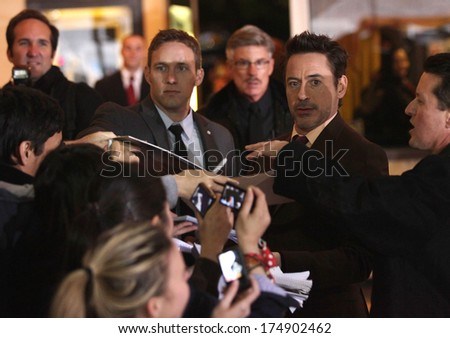 "LOS ANGELES - DEC 06:  ROBERT DOWNEY JR. arrives to the ""Sherlock Holmes A Game of Shadows"" Los Angeles Premiere  on December 06, 2011 in Westwood, CA                 - stock photo"