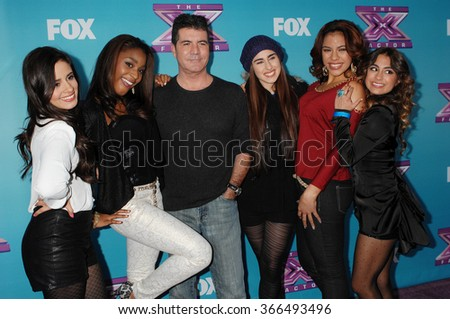 LOS ANGELES - DEC 17 - Simon Cowell and Fifth Harmony arrives at the X Factor Season Finale Press Conference  on December 17, 2012 in Los Angeles, CA              - stock photo