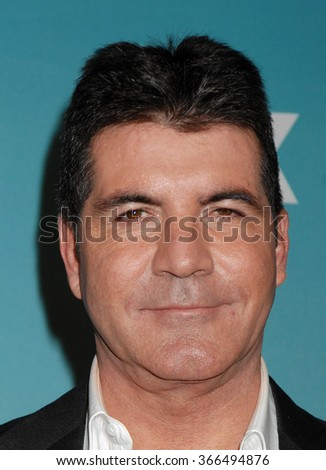 LOS ANGELES - DEC 19 - Simon Cowell arrives at the X Factor 2012 Season Finale Day 1  on December 19, 2012 in Los Angeles, CA