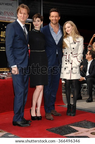LOS ANGELES - DEC 13 - Tom Hooper, Anne Hathaway, Hugh Jackman, Amanda Seyfried at the Hugh Jackman Star On The Hollywood Walk Of Fame Ceremony on December 13, 2012 in Los Angeles, CA              - stock photo