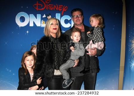 "LOS ANGELES - DEC 11:  Tori Spelling, Dean McDermott, Liam, Stella, Hattie, Finn McDermott at the ""Disney on Ice"" Red Carpet Reception at the Staples Center on December 11, 2014 in Los Angeles, CA - stock photo"