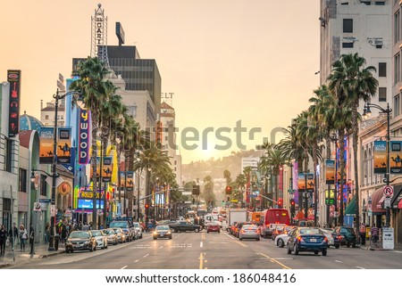 LOS ANGELES - DECEMBER 18, 2013: View of Hollywood Boulevard at sunset. In 1958, the Hollywood Walk of Fame was created on this street as a tribute to artists working in the entertainment industry. - stock photo