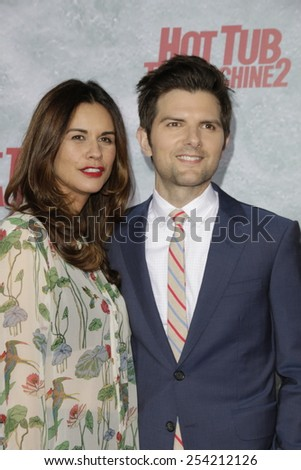 LOS ANGELES - FEB 18: Adam Scott, wife at the 'Hot Tub Time Machine 2' premiere on February 18, 2014 in Los Angeles, California - stock photo