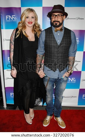 LOS ANGELES - FEB 8 - AJ Mclean and wife arrives at the 16th Annual Friends N Family Pre Grammy Party on February 8, 2013 in Los Angeles, CA              - stock photo
