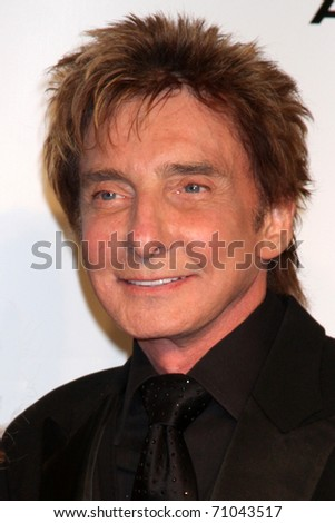 LOS ANGELES - FEB 11:  Barry Manilow arrives at the Muiscares Gala Honoring Barbra Streisand at Convention Center on February 11, 2011 in Los Angeles, CA
