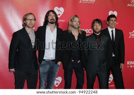 LOS ANGELES - FEB 10:  Foo Fighters arrives at the 2012 MusiCares Gala honoring Paul McCartney at LA Convention Center on February 10, 2012 in Los Angeles, CA - stock photo