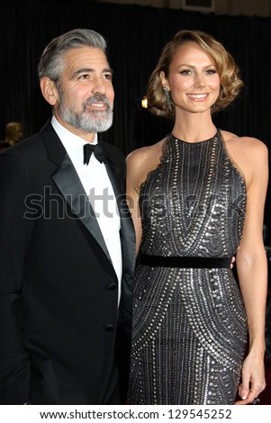 LOS ANGELES - FEB 24:  George Clooney, Stacy Keibler arrive at the 85th Academy Awards presenting the Oscars at the Dolby Theater on February 24, 2013 in Los Angeles, CA - stock photo