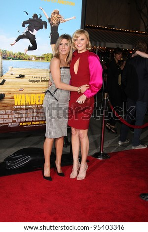 "LOS ANGELES - FEB 16:  Jennifer Aniston, Malin Akerman arrives at the ""Wanderlust"" World Premiere at the Village Theater on February 16, 2012 in Westwood, CA"