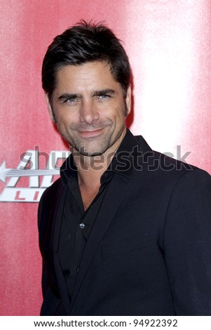 LOS ANGELES - FEB 10:  John Stamos arrives at the 2012 MusiCares Gala honoring Paul McCartney at LA Convention Center on February 10, 2012 in Los Angeles, CA - stock photo