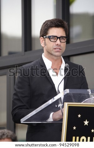 LOS ANGELES - FEB 6: John Stamos at a ceremony where rock band 'America' in honored with a star on the Hollywood Walk of Fame in Los Angeles, California. Feb 6, 2012