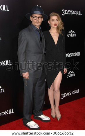 LOS ANGELES - FEB 12:  Johnny Depp and Amber Heard arrives to the 3 Days To Kill US Premiere  on February 12, 2014 in Hollywood, CA                 - stock photo
