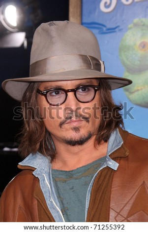 LOS ANGELES - FEB 14:  Johnny Depp arrives at the Rango Premiere at Village Theater on February 14, 2011 in Westwood, CA - stock photo