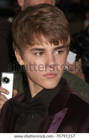 "LOS ANGELES - FEB 8:  Justin Bieber arrives at the ""Never Say Never"" Premiere at Nokia Theater  on February 8, 2011 in Los Angeles, CA"