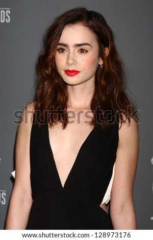 LOS ANGELES - FEB 19:  Lily Collins arrives at the 15th Annual Costume Designers Guild Awards at the Beverly HIlton Hotel on February 19, 2013 in Beverly Hills, CA