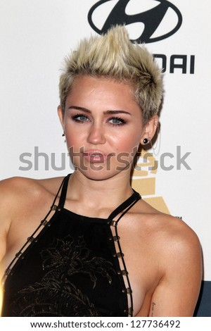 LOS ANGELES - FEB 9:  Miley Cyrus arrives at the Clive Davis 2013 Pre-GRAMMY Gala at the Beverly Hilton Hotel on February 9, 2013 in Beverly Hills, CA - stock photo