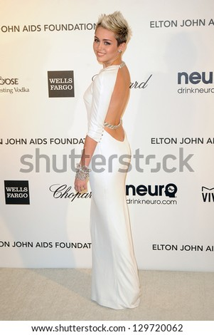 LOS ANGELES - FEB 24:  Miley Cyrus arrives at the Elton John Aids Foundation 21st Academy Awards Viewing Party at the West Hollywood Park on February 24, 2013 in West Hollywood, CA - stock photo