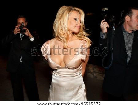 "LOS ANGELES - FEB. 12: Pamela Anderson attends the ""Fame At The Mansion"" 2012 Grammy Aterparty hosted by Sean ""Diddy"" Combs at the Playboy Mansion in Los Angeles on Feb. 12, 2012. - stock photo"