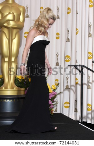 LOS ANGELES -  FEB 27: Reese Witherspoon leaves the Press Room at the 83rd Academy Awards at Kodak Theater, Hollywood & Highland on February 27, 2011 in Los Angeles, CA - stock photo