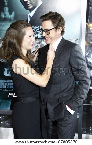 LOS ANGELES - FEB 16: Robert Downey Jr and wife Susan Downey at the premiere of 'Unknown' held at the Regency Village Theater in Los Angeles, California on February 16, 2011 - stock photo