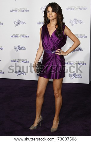 LOS ANGELES - FEB 8: Selena Gomez arriving at the Los Angeles premiere of 'Justin Bieber: Never Say Never' at the Nokia Theater L.A.Live in Los Angeles, California. on February 8, 2011. - stock photo