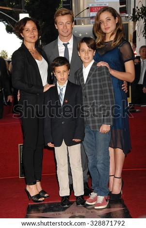 LOS ANGELES - FEB 14 - Simon Baker, Rebecca Rigg, Stella, sons Claude,Harry arrives at the Simon Baker  Star On The Hollywood Walk Of Fame Ceremony on February 14, 2013 in Los Angeles, CA              - stock photo