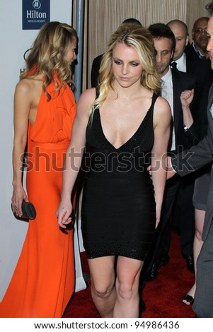 LOS ANGELES - FEB 11:  Tamara Braun getting out of the way as Britney Spears arrives at the Pre-Grammy Party hosted by Clive Davis at the Beverly Hilton Hotel on February 11, 2012 in Beverly Hills, CA - stock photo