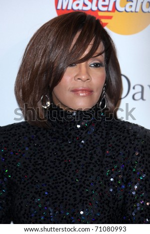 LOS ANGELES - FEB 12:  Whitney Houston arrives at the 2011 Pre-GRAMMY Gala And Salute To Industry Icons  at Beverly Hilton Hotel on February 12, 2011 in Beverly Hills, CA - stock photo