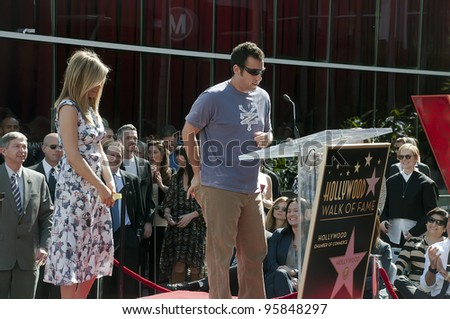 LOS ANGELES - FEBRUARY 22: Actor-comedian Adam Sandler speaks at the Jennifer Aniston Hollywood Walk of Fame Star Ceremony at Hollywood Blvd on February 22,  2012 in Los Angeles, CA. - stock photo