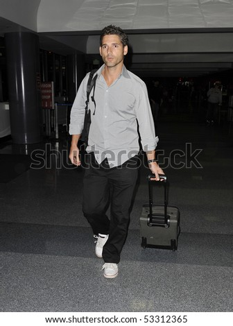 LOS ANGELES - FEBRUARY 6: Australian actor Eric Bana is seen making his way thru LAX (Los Angeles Airport) carrying his luggage. February 6, 2010 in los angeles, california