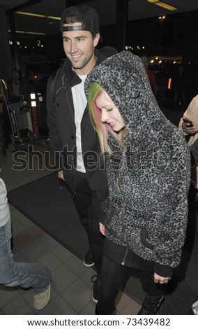 LOS ANGELES - FEBRUARY 5: Avril Lavigne and Brody jenner at LAX . February 5th 2011 in Los Angeles, California