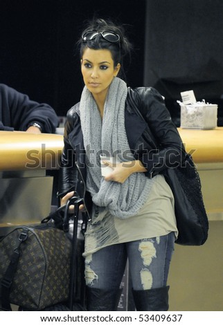 LOS ANGELES - FEBRUARY 21 : Model and socialite kim Kardashian is seen with her luggage at LAX. February 21, 2010 in Los Angeles, California - stock photo