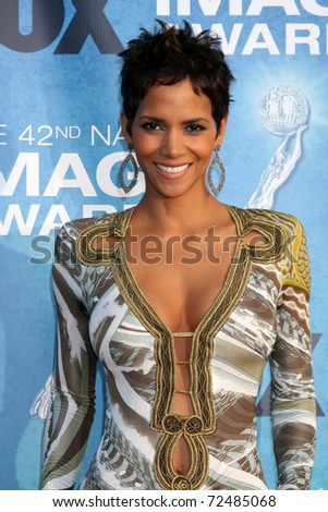 LOS ANGELES -  4: Halle Berry arriving at the 42nd NAACP Image Awards at Shrine Auditorium on March 4, 2011 in Los Angeles, CA - stock photo