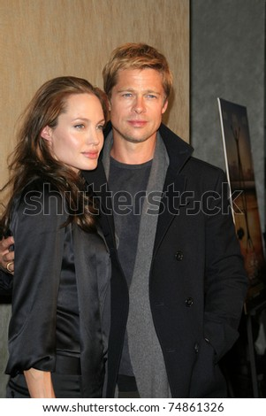 LOS ANGELES - JAN 8: Brad Pitt and Angelina Jolie arrive at the premiere of 'God Grew Tired Of Us' at the Pacific Design Center on January 8, 2007 in West Hollywood, Los Angeles, CA. - stock photo